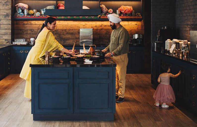 Family preparing a meal in modern kitchen