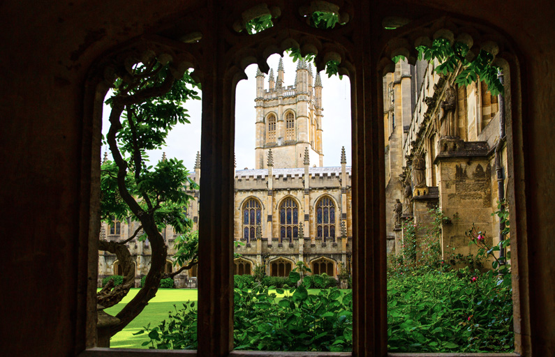 Framed view of a stately university from within the grounds