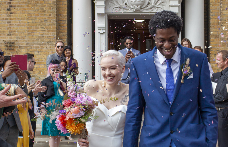 Newlyweds being celebrated walking out of wedding ceremony